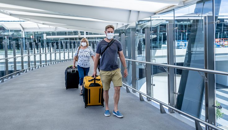 A senior women with her son just at the airport wearing mask because of COVID 19