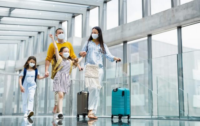 A family is departing at the airport for international travel