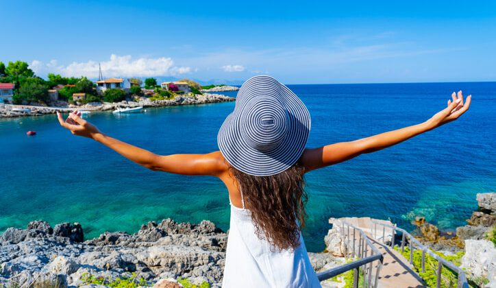 A young lady enjoying a scenic view of Zakynthos Greece during her Europe travel