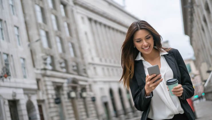 A young girl using iPhone messaging app to send a message abroad